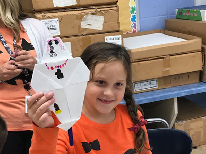 First Graders Fold Origami Ghosts