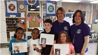 Pictured in the photo with Tooker Avenue students are Navy veteran and Tooker Avenue paraprofessional Nicole Grahofke (left) and teacher Debbie Goodwin.